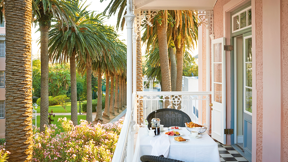 Pink hotel in Cape Town with balcony at breakfast