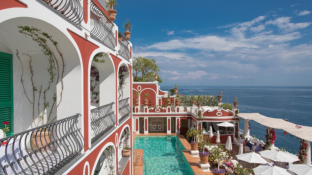 resort in Italy overlooking ocean with pool