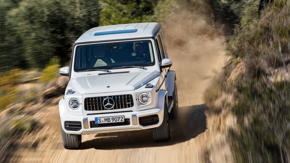 A 2019 Mercedes-AMG G63 on a dirt road.
