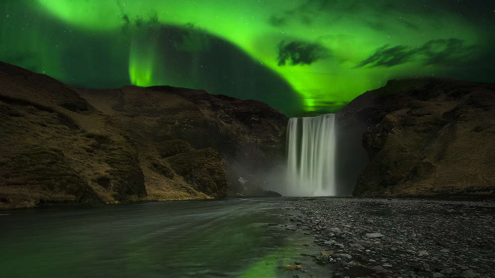 waterfall northern lights Iceland aurora borealis