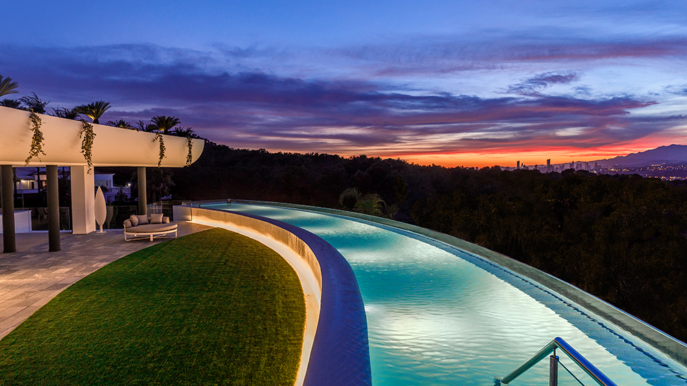 modern architecture pool sunset in Spain