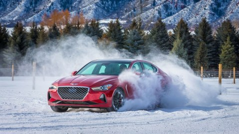 The Genesis G70 sedan being driven in snow.