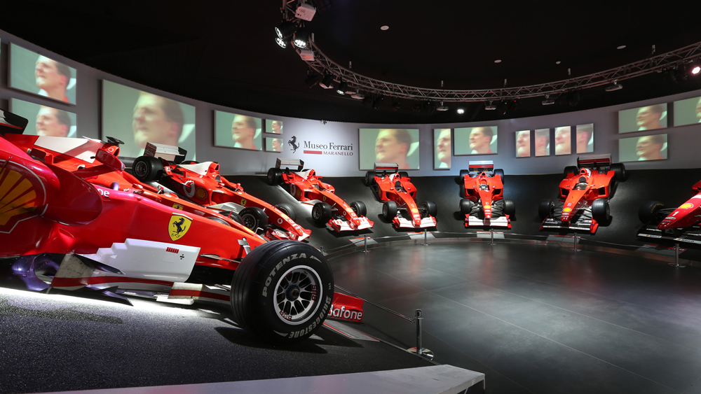 A display of Michael Schumacher's race cars.