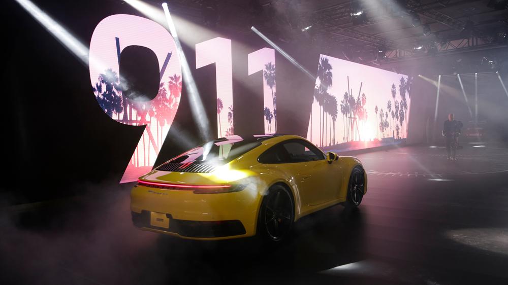 The 2020 Porsche 911 makes an entrance at the LA Auto Show.