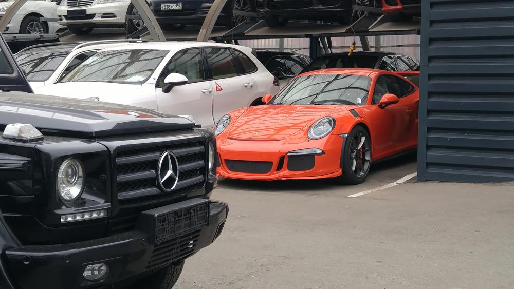 A Mercedes-Benz G-Class and Porsche 911.