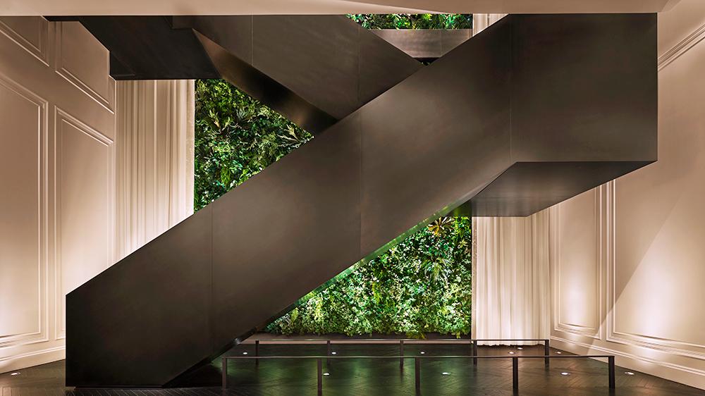 lobby staircase green wall New York city hotel