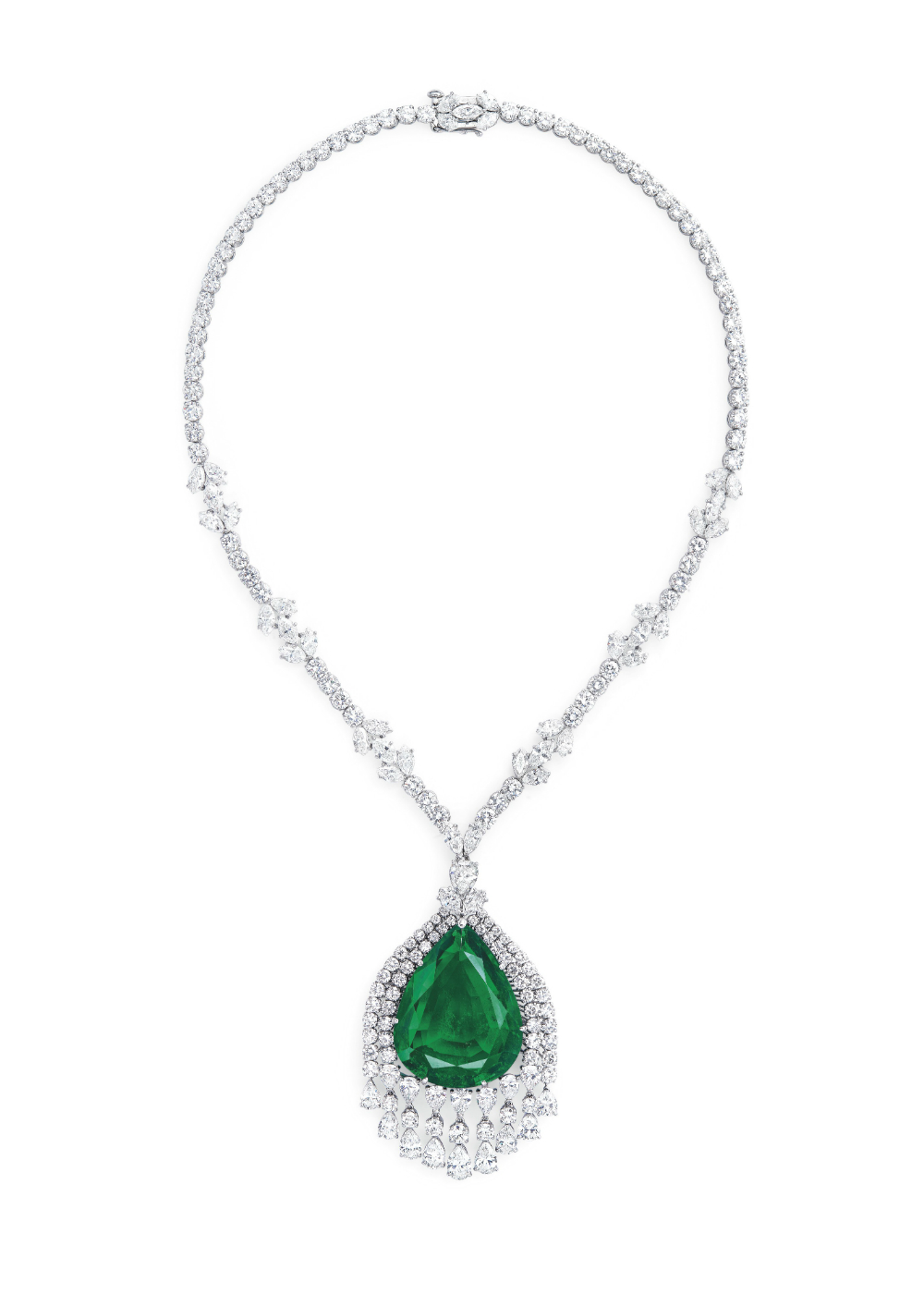 The emerald was cut from a rectangle to its current pear shape in order to enhance its natural brilliance.