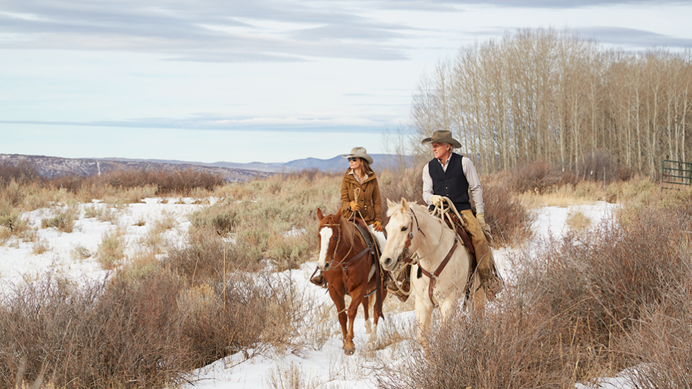 Norman and his wife explore the property from horseback.