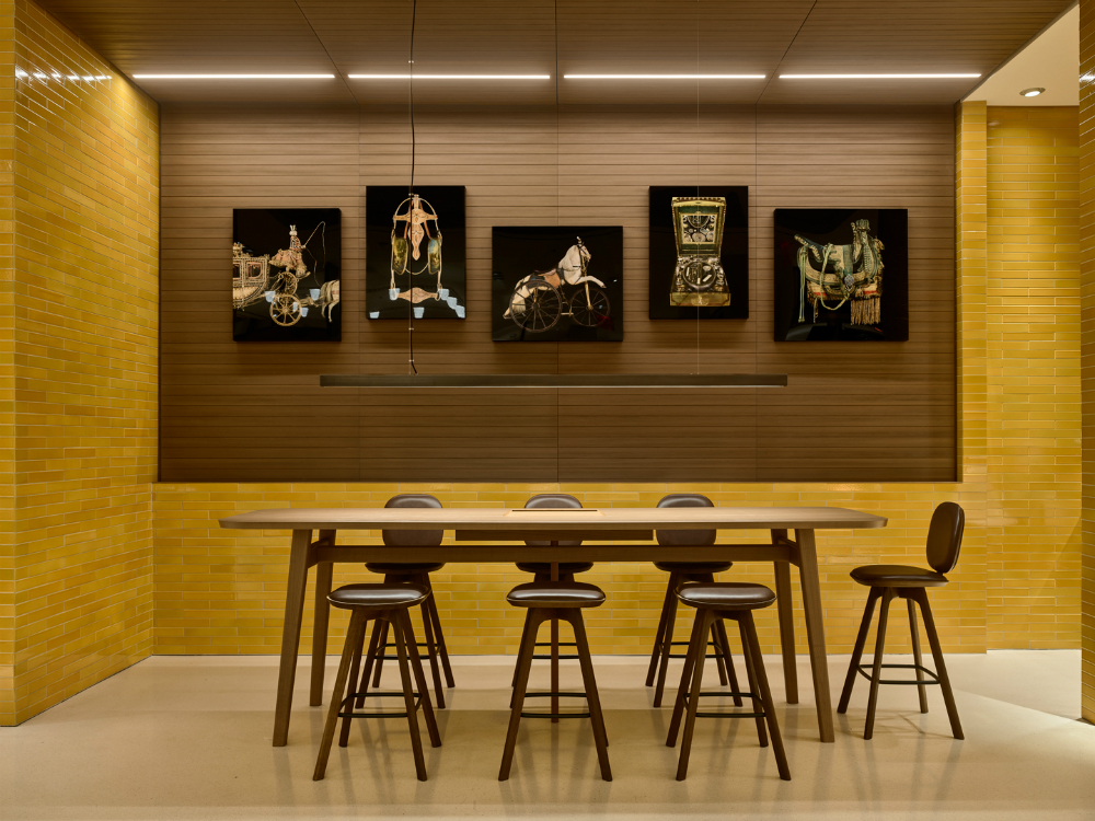 At the back of the first floor, there's a table where guests can enjoy a cup of coffee.