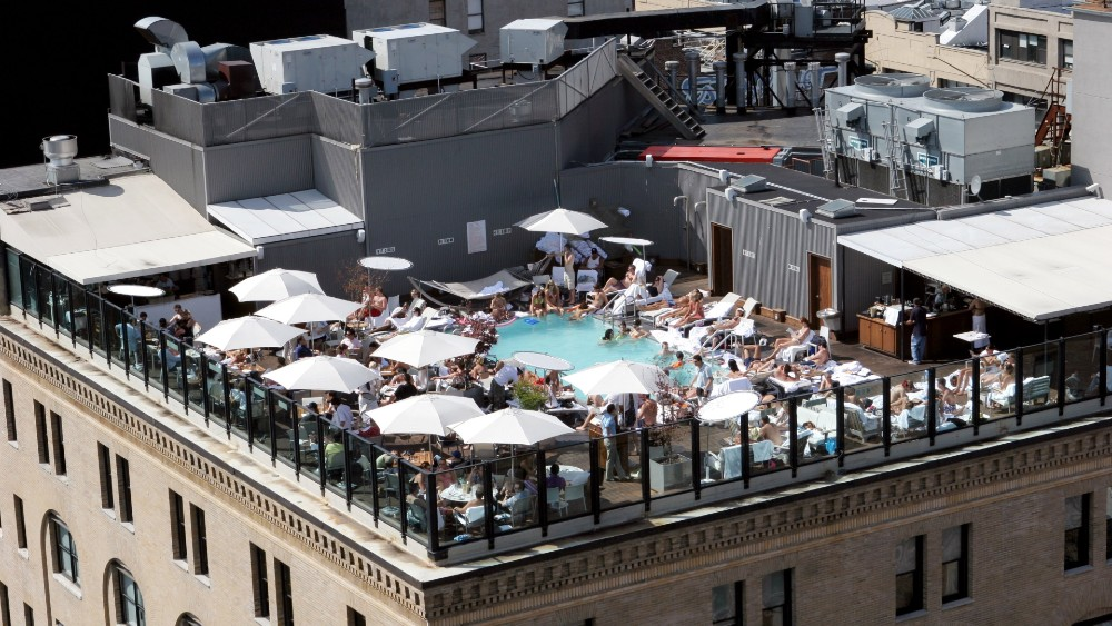 A view of New York's rooftop pool and bar