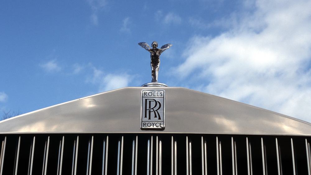 Rolls-Royce grille with Spirit of Ecstasy hood ornament.
