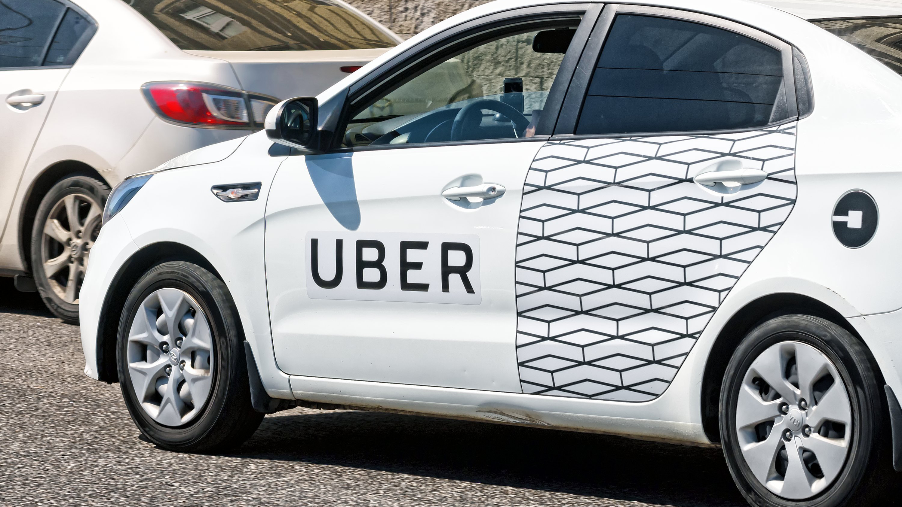 For many, Uber's on-demand system poses a threat to a culture of car ownership.