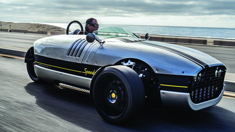Viju Mathew driving the three-wheeled Vanderhall Venice Speedster in California