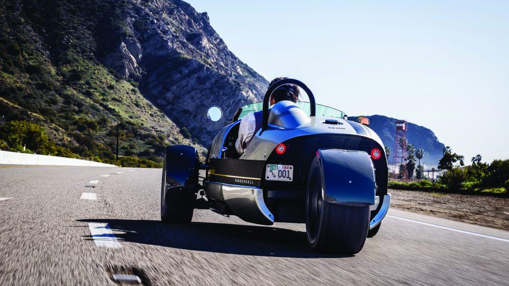 Viju Mathew behind the wheel of the three-wheeled Vanderhall Venice Speedster in California