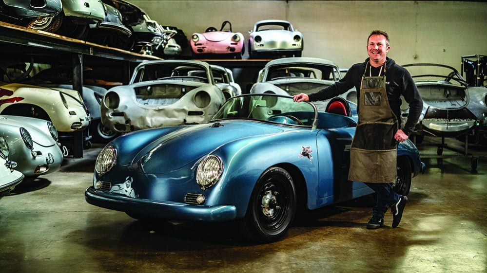 Rod Emory in his shop next to one of his creative restorations;