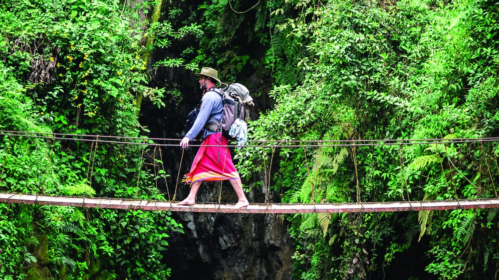 Henry Cookson on a footbridge near the base of the Tisquizoque Windows waterfall in Colombia