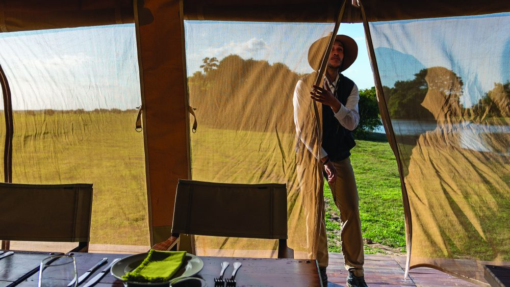 A staffer at Corocora in Colombia prepares the main tent for a meal.