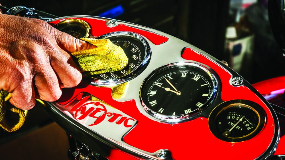 Bueno buffs the ampere dial, clock, speedometer and gas-level indicator on the 1929 Majestic.