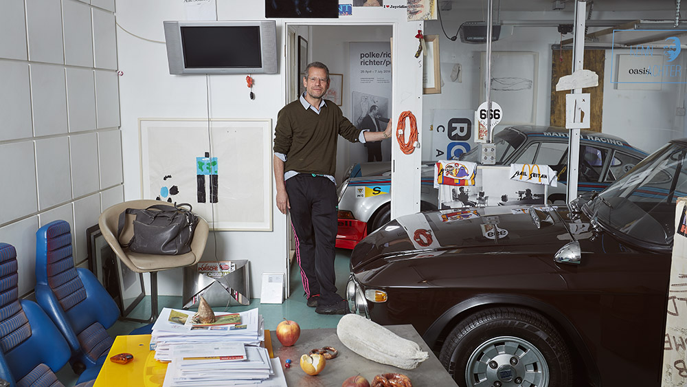 Kenny Schachter at his classic-car-filled office in Kensington, London.