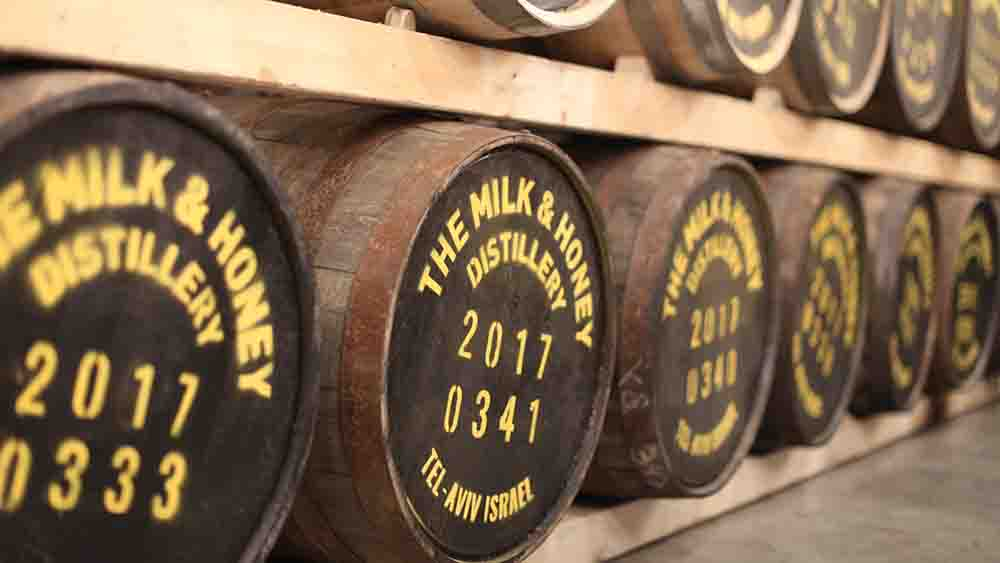 Barrels of whisky aging at Milk and Honey Distillery