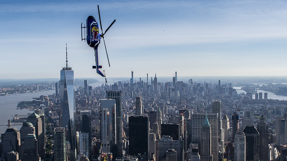 Red Bull Aerobatic Helicopter Pilot, Aaron Fitzgerald, performs flips, barrel rolls and nose dives over the New York City skyline during the morning hours on May 18th 2019. // Predrag Vuckovic/Red Bull Content Pool // AP-1ZCFY41QD1W11 // Usage for editorial use only // Please go to www.redbullcontentpool.com for further information. //