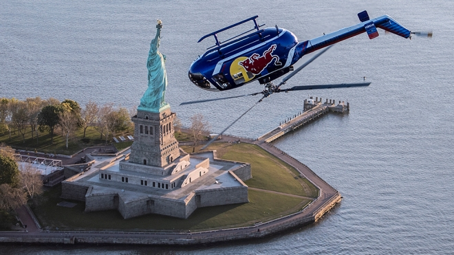 Red Bull Aerobatic Helicopter Pilot, Aaron Fitzgerald, performs flips, barrel rolls and nose dives in front of the Statue of Liberty during the morning hours on May 18th 2019. // Predrag Vuckovic/Red Bull Content Pool // AP-1ZCFY5MT91W11 // Usage for editorial use only // Please go to www.redbullcontentpool.com for further information. //