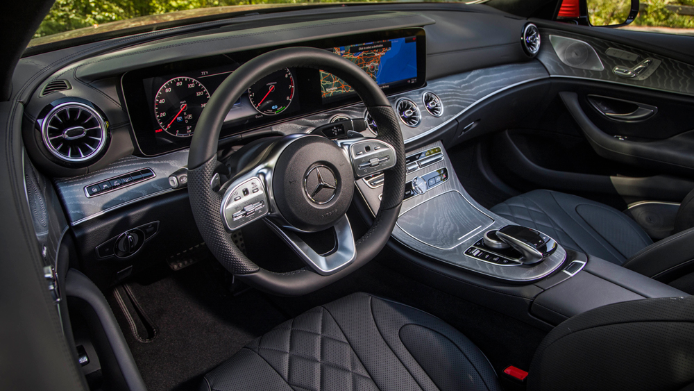 The interior's two widescreen displays are controlled by rotary knob or thumb pads on the steering wheel.
