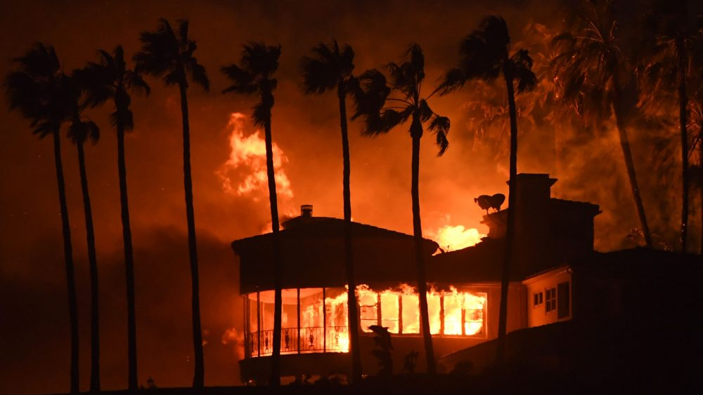 A house burns during the Woolsey Fire on November 9, 2018 in Malibu, California. - About 75,000 homes have been evacuated in Los Angeles and Ventura counties due to two fires in the region. (Photo by Robyn Beck / AFP) (Photo credit should read ROBYN BECK/AFP/Getty Images)
