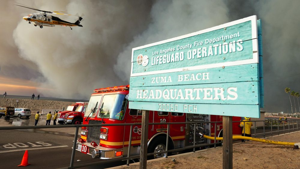 An LA County fire helicopter takes off from the Zuma Beach helipad during the Woolsey Fire in Malibu on Friday, Nov. 9, 2018.