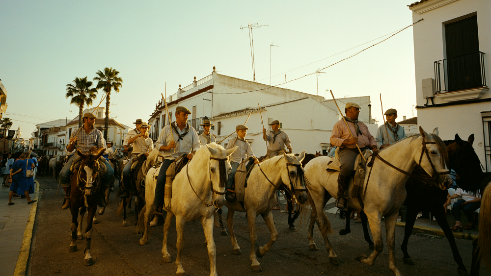 Ganaderos parading through the town of Almonte