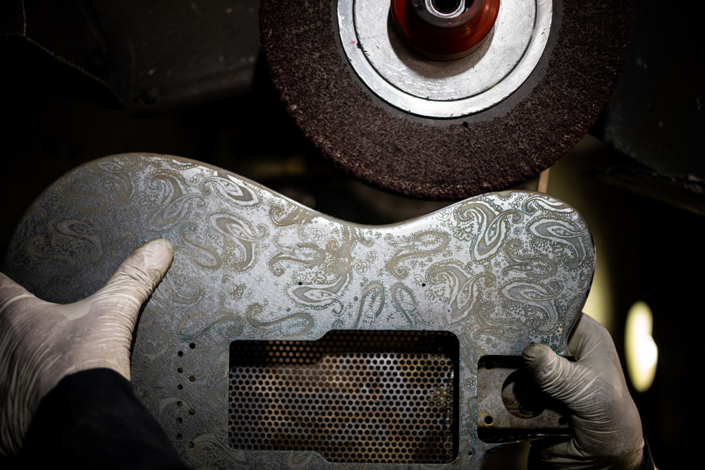 After being screen printed, dried and sprayed with the fixer, the guitar body gets polished at James Trussart's workshop in East Los Angeles.