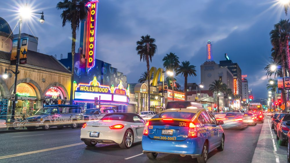 The people of LA driving their cars on Hollywood Boulevard.