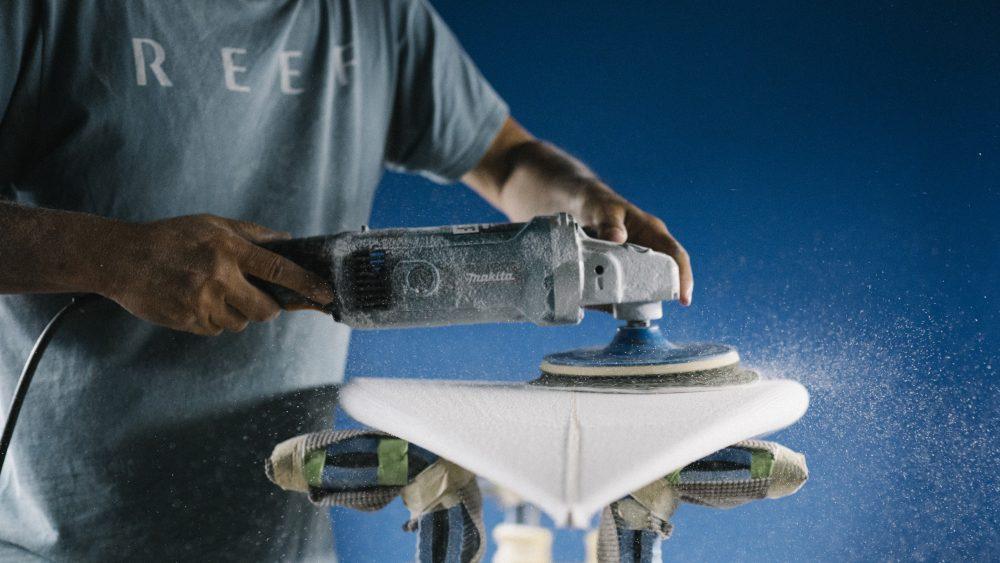 """The shaper """"scrubs"""" the Jon Pyzel surfboard"""