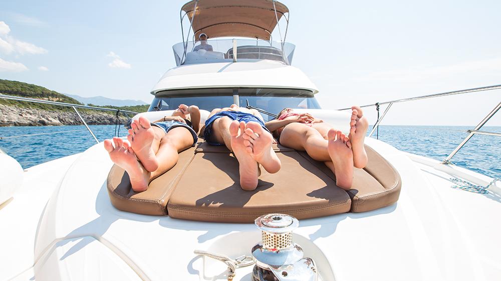 Millennials enjoying a yacht holiday in the sea