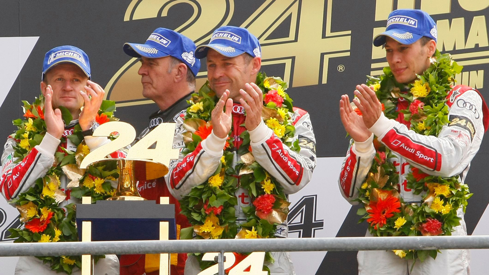 Tom Kristensen and team celebrating victory at Le Mans in 2013.
