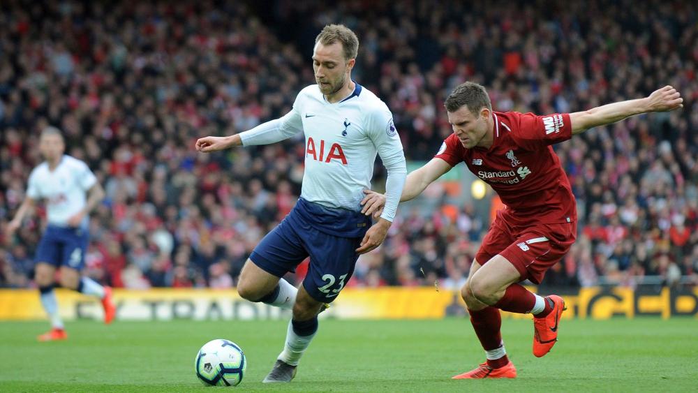 Tottenham Hotspur's Christian Eriksen and Liverpool's James Milner
