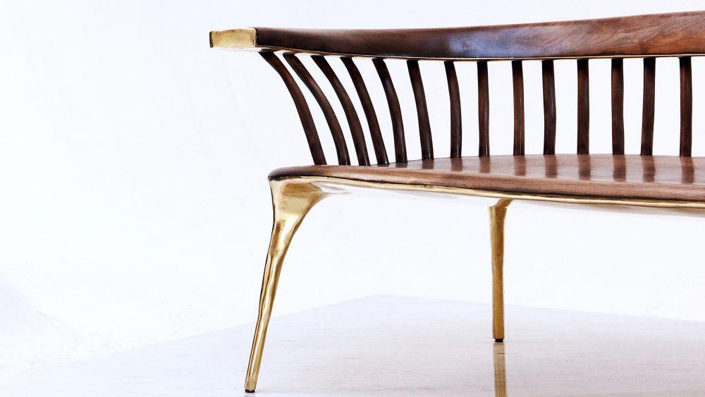 Valentin Loellmann's walnut and solid brass sofa
