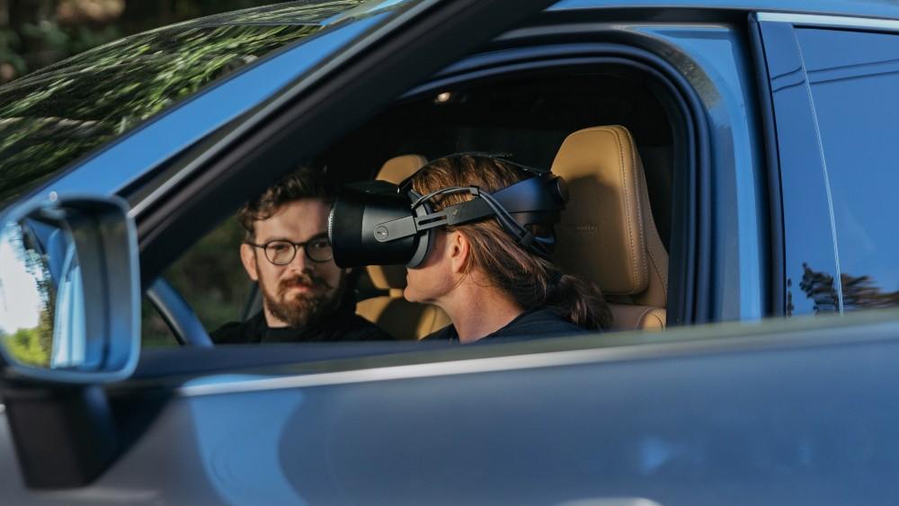 A Volvo engineer wearing a Varjo headset