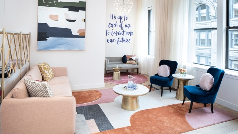 """Trellis' reception and """"influencer wall,"""" which features a quote from Michelle Obama."""