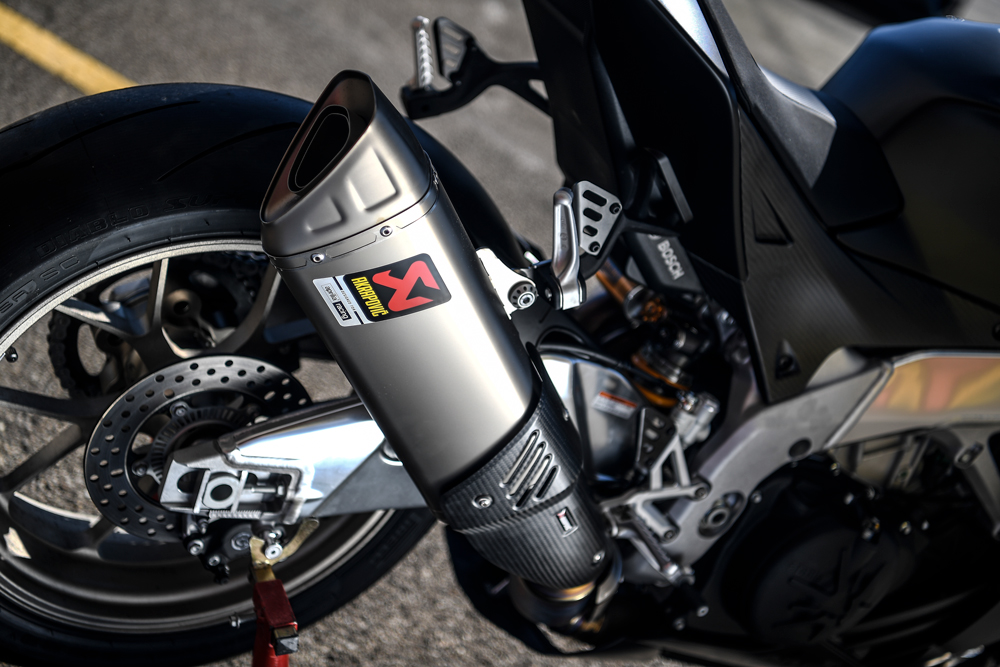 The bike's titanium Akrapovic exhaust provides a serious soundtrack to the action.