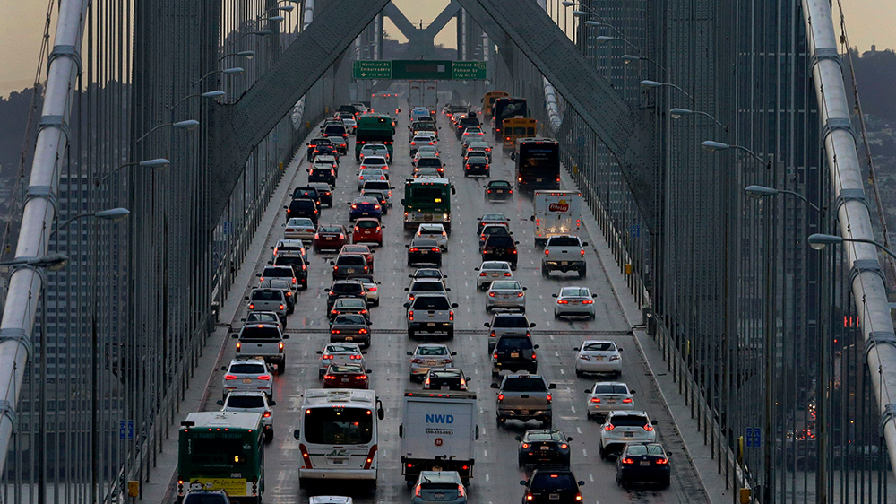 San Francisco-Oakland Bay Bridge Traffic Vehicles make their way westbound on Interstate 80 across the San Francisco-Oakland Bay Bridge as a new series of rain storms bear down on the Bay Area, as seen from Treasure Island in San Francisco California Weather, San Francisco, USA