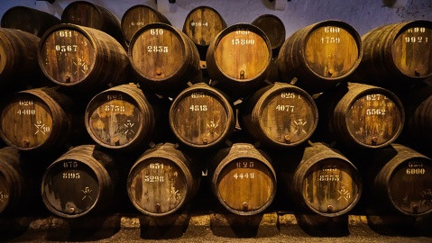 Old aged traditional wooden barrels with wine in a vault lined up in cool and dark cellar in Italy, Porto, Portugal, France; Shutterstock ID 1367965925; Notes: Robb Report—Whisky Auction