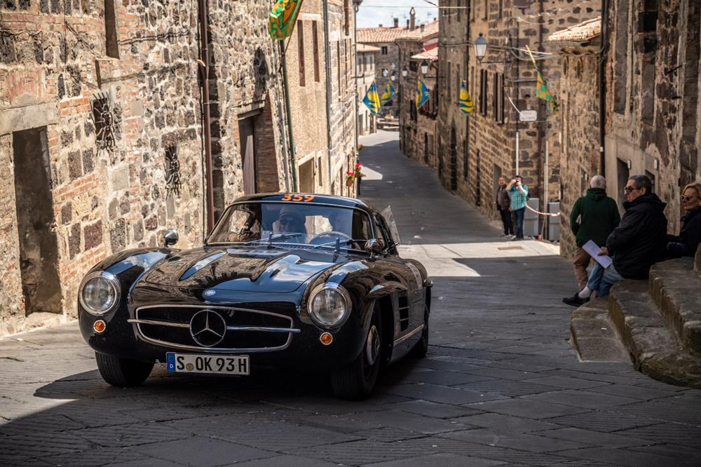 Walker winding his way through a timeless Italian village.
