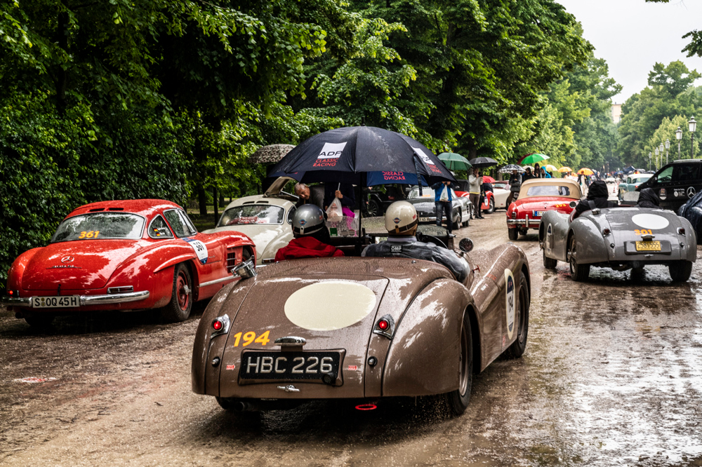 Renowned roadsters and coupes braving the elements.