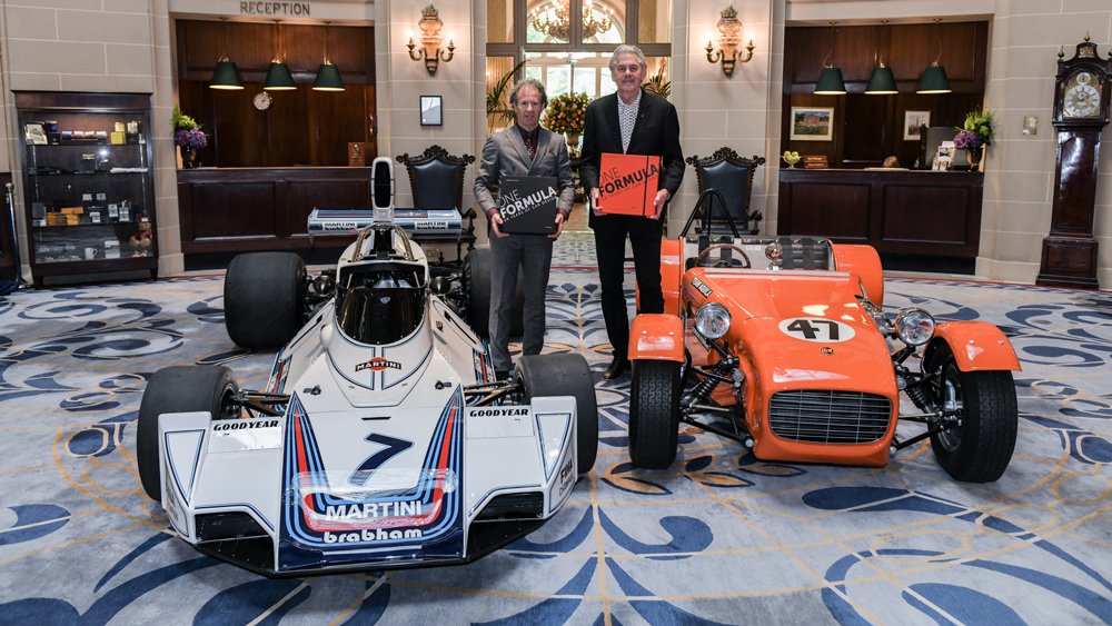 Gordon Murray (right) and Phillip Porter with One Formula: 50 Years of Car Design.