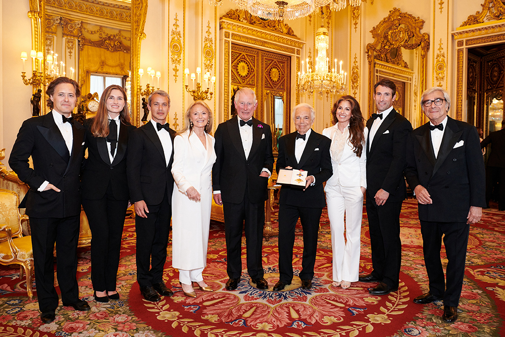 Ralph Lauren's family with Prince Charles after he received his honorary knighthood.