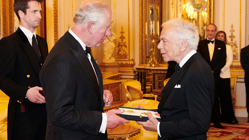 Prince Charles grants Ralph Lauren an honorary knighthood.