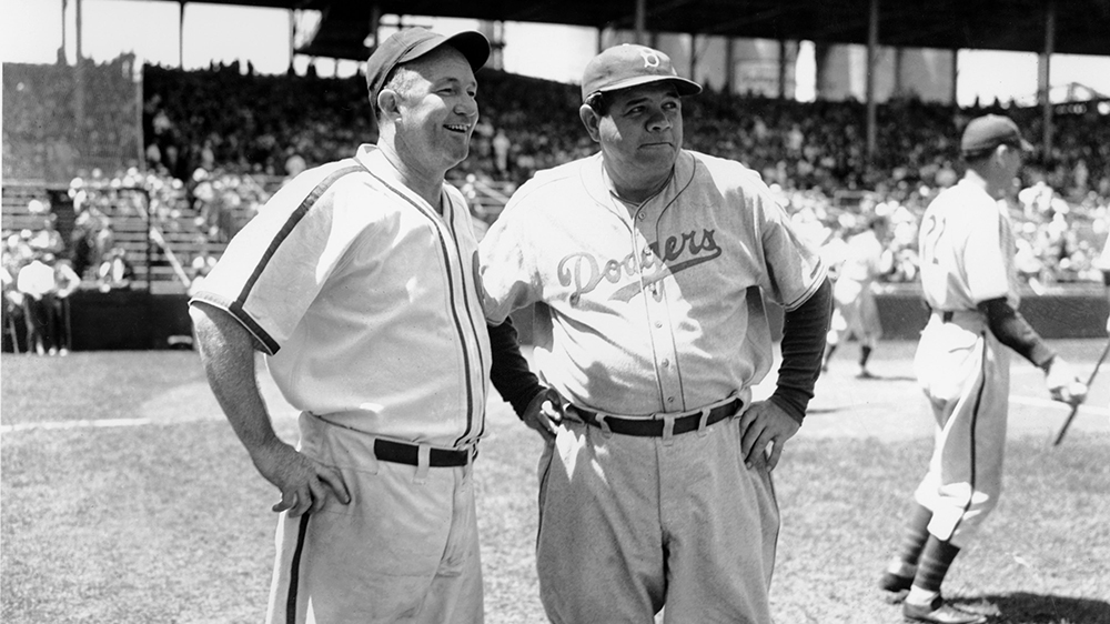 Chicago Cubs manager Gabby Hartnett, left, chats with Brooklyn Dodgers coach Babe Ruth
