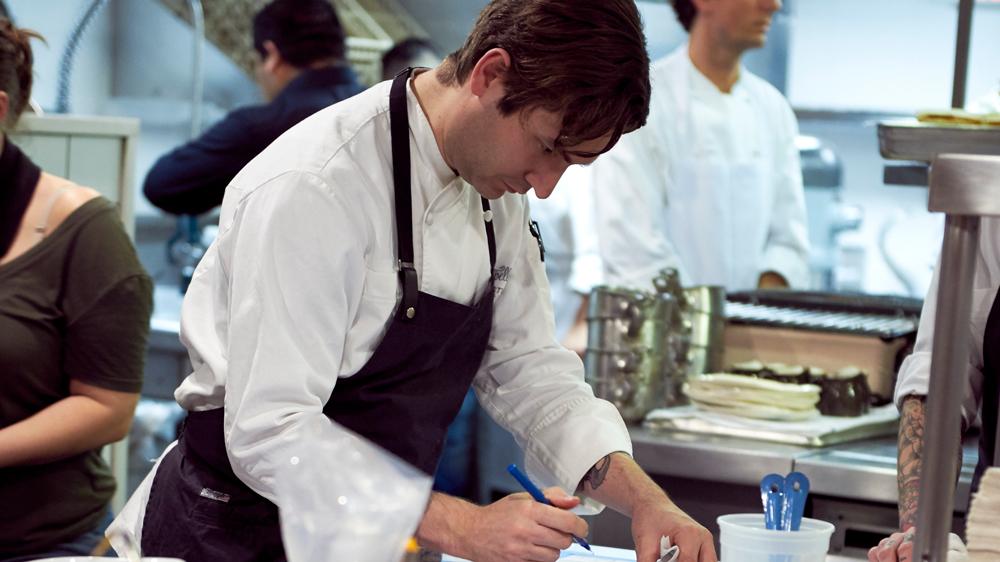 Alex Stupak working at Empellón