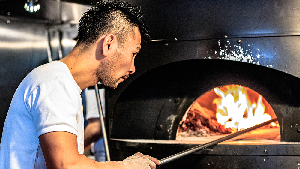 Wood-fired pizza oven at Studio Tamaki Japan